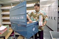 Treatment guidelines endorsed by the World Health Organization have worldwide impact. Here, Aldo Argola, a WHO librarian in Geneva, loads treatment guidelines and medical books into a trunk that will be sent to a health center that lacks up-to-date information. The WHO has sent these portable medical libraries to more than 1,400 health centers in 60 nations.