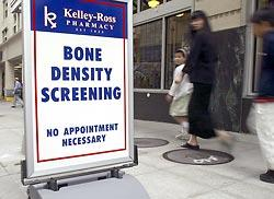 A sidewalk sign at Kelley-Ross Pharmacy in Seattle advertises bone-density screening. Such screening has proliferated in recent years, targeting younger, healthier people.