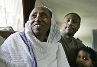 As a U.S. citizen, Laine Seleba, right, of Shoreline, petitioned to get a green card for his mother, Werku Tekle, 70, left, of Eritrea. She received it. At lower right is Seleba's son, Nathaniel.