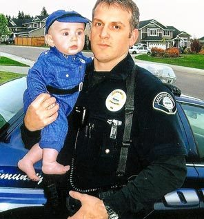 Lakewood Sgt. Mark Renninger is shown with his son, Nicholas, about two years ago.