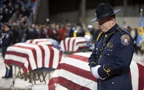 Honor Guard Jeremy Price of the Portland Police Bureau stands next to the casket of Lakewood Police Officer Greg Richards prior to the public memorial service for the fallen officers at the Tacoma Dome on Dec. 8.