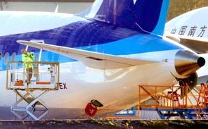 A Boeing worker checks a 787 Dreamliner tail last December at Paine Field. News about the plane was much sought-after in 2010.