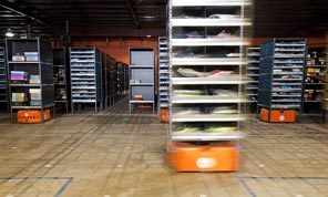 A Kiva robot moves a portable shelf at an Acumen Brands warehouse in Fayetteville, Ark., last year. To further automate its business, Amazon.com agreed to buy Kiva Systems for $775 million, its biggest acquisition since its 2009 purchase of Zappos.com.