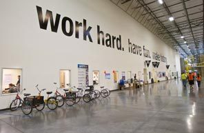 Amazon.com's motto is displayed in its state-of-the-art West Phoenix fulfillment center. Although this 2-year-old center has air conditioning, some older Amazon warehouses did not, and workers suffered from heat-related illnesses trying to keep up with the relentless drive to boost production.