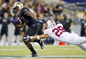Bishop Sankey escapes the efforts of Stanford's Ed Reynolds, and then breaks free for a 61-yard touchdown in the third quarter that came on a fourth-and-one gamble for Washington.