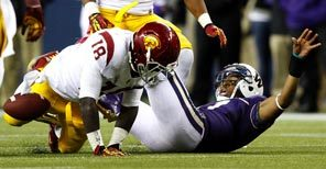 Washington quarterback Keith Price fumbles the ball after a hit by USC's Dion Bailey. It was the second fumble lost by Price in the fourth quarter of the Huskies' 24-14 loss.