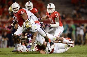 Washington running back Bishop Sankey is taken down in the third quarter. Sankey rushed for 89 yards and a touchdown.