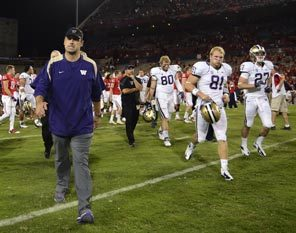 There is no joy for Washington coach Steve Sarkisian as he walks off the field with his team after a 52-17 drubbing in Arizona.