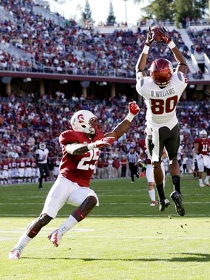 Washington State wide receiver Dominique Williams hauls in a 43-yard reception that helped set up his 3-yard scoring catch.