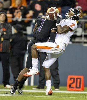 Oregon State receiver Markus Wheaton is leveled by Washington safety Sean Parker, who separates Wheaton from the ball and forces an interception. Wheaton was injured on the play.