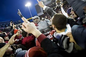 WSU players and fans celebrate on the field at Martin Stadium as the Cougars defeat the Huskies, 31-28, in overtime to win the 2012 Apple Cup.