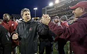 Fans cheer Washington State coach Mike Leach as he walks off the field following Friday's overtime win over Washington.