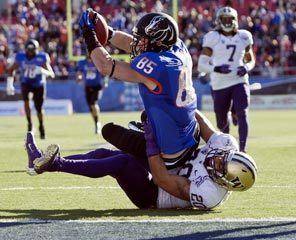 Washington safety Justin Glenn tries to tackle Boise State's Holden Huff before he can break the plane of the goal line in the second quarter. After a review, the officials ruled Huff's 34-yard reception was a touchdown.