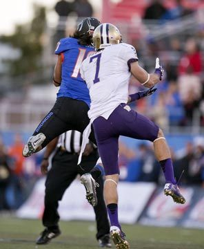 Boise State safety Jeremy Ioane steps in front of Washington's Cody Bruns, making the interception with 14 seconds left that clinched his team's win.