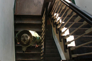 Park ranger Mike Zimmerman, the area manager, descends a stairway in the old Army hospital. Restoration of the interior began in 2005 by the Friends of Fort Flagler. Now the first floor — with kitchen, ballroom and more — is rentable for events.