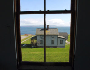 From an upper story of the fort's 12-bed hospital, there are views of vacation and staff housing and Admiralty Inlet with Whidbey Island beyond.