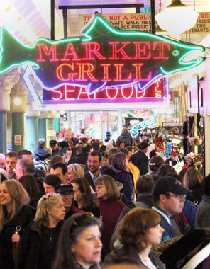 Visitors and locals alike throng the Pike Place Market to shop for flowers, pick up dinner or just watch flying fish.