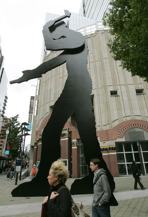"Jonathan Borofsky's kinetic sculpture ""Hammering Man"" is a distinctive landmark outside the Seattle Art Museum."