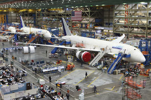 See aircraft being assembled inside the world's largest building during the popular Boeing Tour.