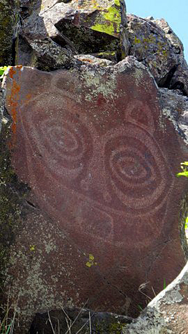 "Tsagaglalal, ""She Who Watches,"" is both painted and incised on a basalt wall. It can be seen only on free guided tours."