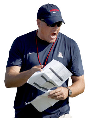 This Aug. 9, 2012 photo shows University of Arizona NCAA college head football coach Rich Rodriguez calling out to his players as they run drills during team practice in Sierra Vista, Ariz. Rodriguez has invigorated Arizona's football program, providing a measure of excitement usually reserved for the Wildcats' storied basketball team. (AP Photo/Arizona Daily Star, Kelly Presnell) NO MAGS NO SALES AZTUS201 -- MBR