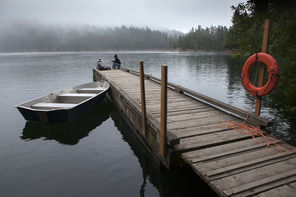 Morning mist   lingers at Mountain Lake in Moran State Park. Paddle on the peaceful lake or walk the four-mile trail around it. Or just relax on the dock, like Jennifer Imamura from Berkeley, Calif. (left) and Sylvia Yang of Anacortes.