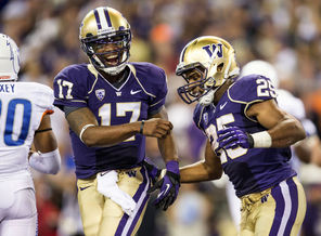 UW quarterback Keith Price celebrates with  Bishop Sankey after Sankey's 23-yard touchdown run in the fourth quarter gave UW a 31-6 lead.