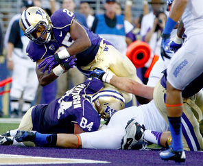 Washington running back Bishop Sankey scores the first touchdown at renovated Husky Stadium in the first quarter.