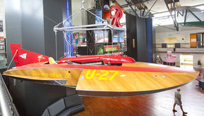The Slo-mo-shun IV hydroplane, which  raced during Seafair in the 1950s, hangs from the ceiling at MOHAI. It's one of many historical artifacts at the museum.