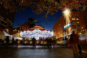 The Holiday Carousel at Westlake Park  and the glowing Macy's star are two beloved signs of  the season  in Seattle.