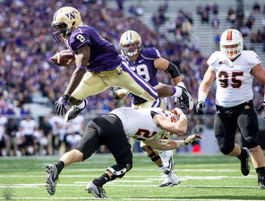 Washington wide receiver Kevin Smith flies over Idaho State's Tanner Davis for a 9-yard gain, much like the Huskies flew past the Bengals in gaining 680 yards.