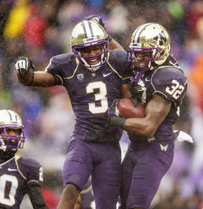 Scoring a safety always gets special-team players  jumping  as Washington's  Cleveland Wallace (3) and Tre Watson (32) enjoy their moment.