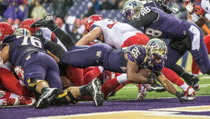 On one of his record 40 carries, Bishop Sankey dives across the goal line for a 1-yard touchdown in the third  quarter that gave the Huskies a 25-13 lead over Arizona.