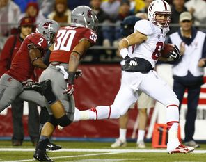Stanford's Devon Cajuste caught two  touchdown passes, including this one of  57 yards,   as the Cardinal jumped out to a 17-3 first-half lead.