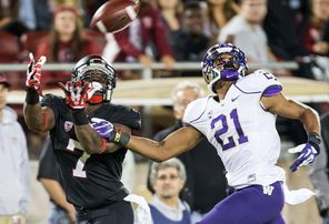 Stanford's Ty Montgomery (7) comes down with this 39-yard touchdown pass in the second quarter against  Washington's Marcus Peters for a 17-7 Cardinal lead.