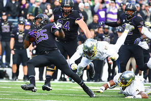 UW's Bishop Sankey, left, had a big day with 167 rushing yards, leaving Oregon's  Brian Jackson (12)  and Erick Dargan (4) behind.