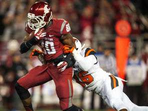 WSU receiver Dom Williams (80) gets tackled from behind by OSU's  Rashaad Reynolds (16). The Cougars passed for 270 yards.