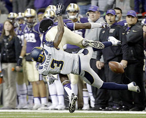 Washington  wide receiver Kasen Williams, top,  gets upended by California's Kameron Jackson (3) and landed awkwardly in the first half. He was taken to the locker room and could be out for the season with a fractured foot.