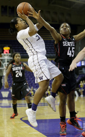 Washington guard Jazmine Davis shoots against Seattle University's Wilma Afunugo in the Huskies'  first victory of the season on Tuesday at Alaska Airline Arena. Davis, a junior,  had 18 points, eight assists and six rebounds.