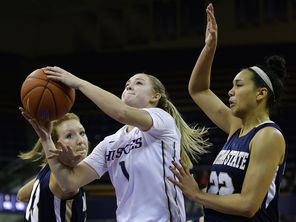 UW guard Mercedes Wetmore, center, drives for a layup against Montana State's Kayla DeWit, left, and Alexa Dawkins  during the second half.