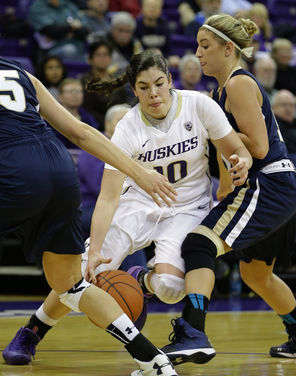 Washington guard Kelsey Plum, left,  is fouled by Montana State's Lindsay Stockton   during the first half.