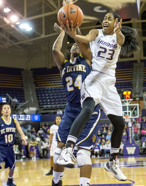 Washington's Aminah Williams hops into the lane looking for a shot, but is fouled by UC Irvine's Camille Buckley during first-half action of the Huskies' victory.<br/>