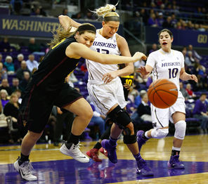 ASU's Sophie Brunner, left, fights UW's Katie Collier, middle, for a loose ball during the Huskies' 78-60 loss at home. Collier, coming off an injury, played just eight minutes.<br/>