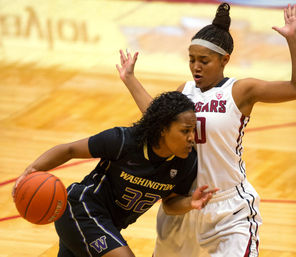 Washington guard Jazmine Davis, left, tries to drive on Washington State's Alexas Williamson. Davis scored 27.<br/>