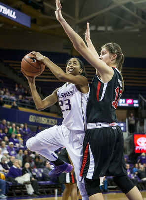 Washington's Aminah Williams eyes the bucket as she works her way around Utah's Emily Potter. Williams finished with three points and 15 rebounds for the Huskies.