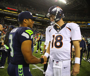 Seahawks QB Russell Wilson, left, greeting  Broncos counterpart Peyton Manning after an exhibition game, faces him again  in the Super Bowl.