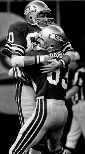 Seahawks receiver Steve Largent, left, is lifted off the ground by Steve Raible after Largent caught a 43-yard touchdown pass to beat Denver for the first time.
