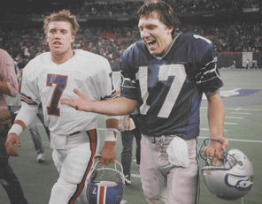 """We won our first playoff game against Denver and hopefully the first Super Bowl win is against the Broncos,"" said Dave Krieg, right, with John Elway."