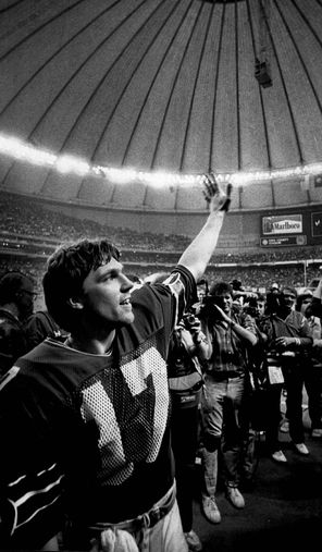 Quarterback Dave Krieg waves to the crowd after directing the Seahawks to their first playoff victory, 31-7 over the Broncos.
