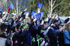 "Fans lined the route from the Virginia Mason Athletic Center in Renton to SeaTac airport to see the Seahawks off on Sunday. ""It was very collegiate-like,"" Pete Carroll said."